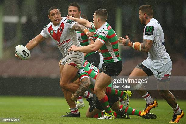 Tyson Frizell of the Dragons passes to Josh Dugan of the Dragons as he is tackled during the round three NRL match between the St George Dragons and...