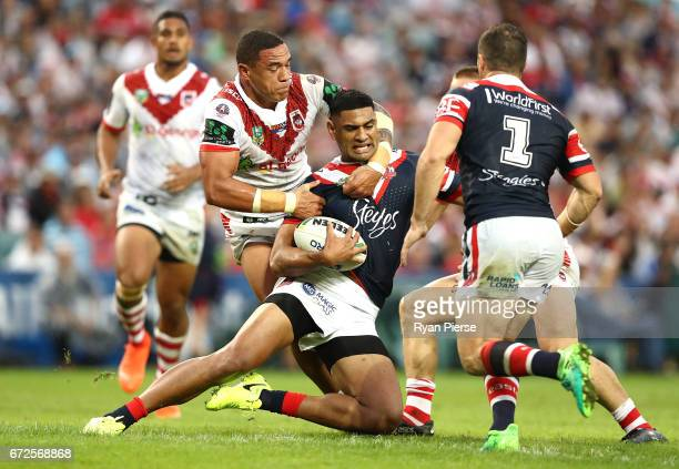 Tyson Frizell of the Dragons tackles Daniel Tupou of the Roosters during the round eight NRL match between the Sydney Roosters and the St George...