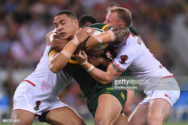 Tyson Frizell of the Kangaroos is tackled during the 2017 Rugby League World Cup Final between the Australian Kangaroos and England at Suncorp...