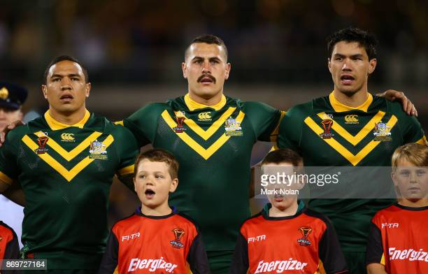 Tyson Frizell Reagan CampbellGillard and Jordan McLean of Australia sing the national anthem before the 2017 Rugby League World Cup match between...