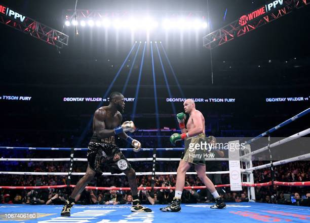 Tyson Fury and Deontay Wilder in the first round fighting to a draw during the WBC Heavyweight Championship at Staples Center on December 1 2018 in...