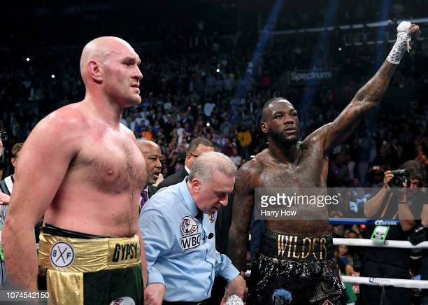 Tyson Fury and Deontay Wilder wait for a decision with referee Jack Reiss before a draw is announced during the WBC Heavyweight Championship at...