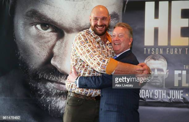 Tyson Fury and promoter Frank Warren embrace during a press conference on April 26 2018 at the Lowry Hotel in Manchester England Fury is due to make...