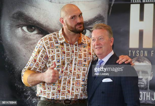 Tyson Fury and promoter Frank Warren pose during a press conference on April 26 2018 at the Lowry Hotel in Manchester England Fury is due to make his...