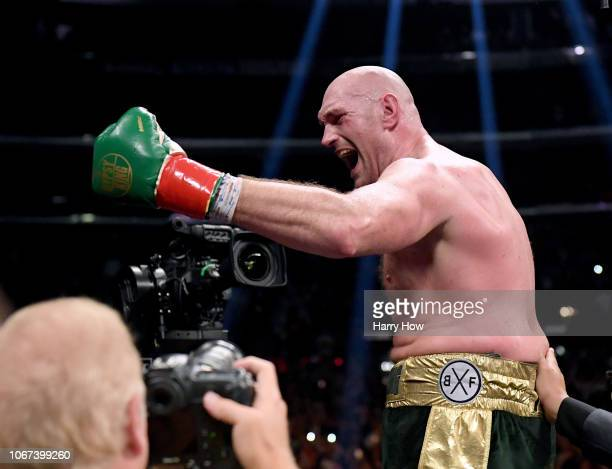Tyson Fury celebrates at the end of the 12th round fighting to a draw with Deontay Wilder during the WBC Heavyweight Championship at Staples Center...