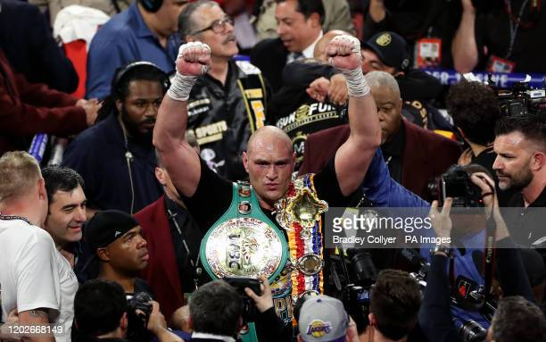 Tyson Fury celebrates defeating Deontay Wilder in the World Boxing Council World Heavy Title bout at the MGM Grand Las Vegas