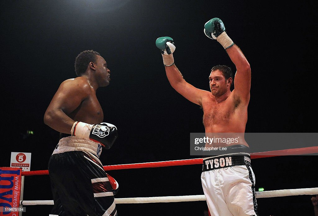 Tyson Fury (R) celebrates his victory after the final round against Dereck Chisora during the British & Commonwealth Heavyweight Title Fight between Dereck Chisora and Tyson Fury at Wembley Arena on July 23, 2011 in London, England.