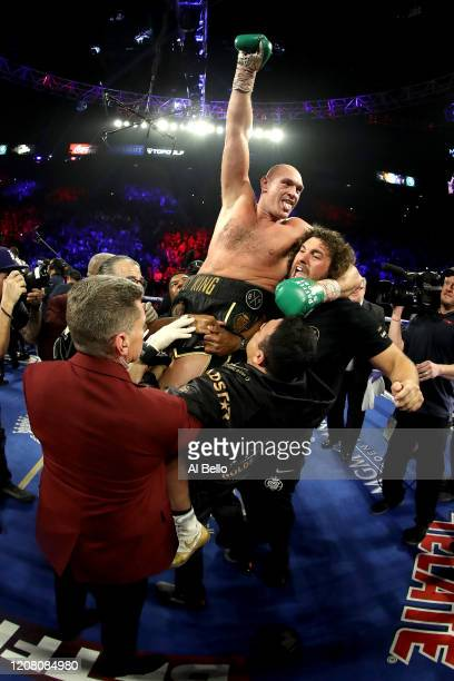 Tyson Fury celebrates his win by TKO in the seventh round against Deontay Wilder in the Heavyweight bout for Wilder's WBC and Fury's lineal...