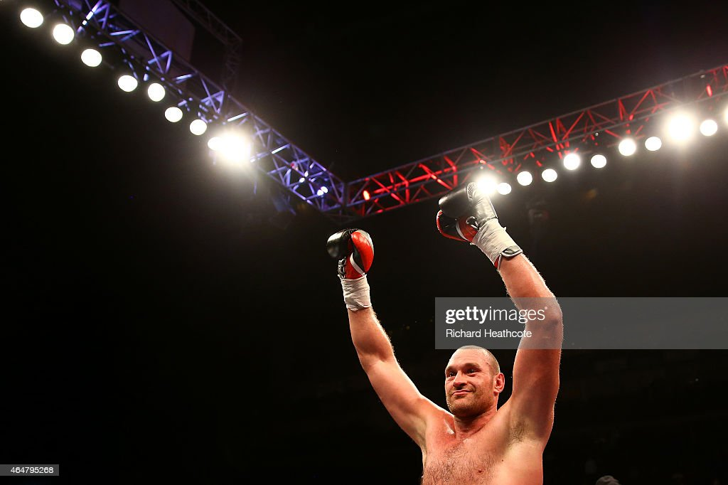 Tyson Fury celebrates victory over Christian Hammer in a Heavyweight Contest at the O2 Arena on February 28, 2015 in London, England.