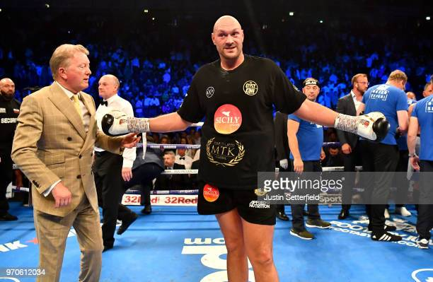 Tyson Fury celebrates victory over Sefer Seferi as his promoter Frank Warren looks on after there heavyweight contest at Manchester Arena on June 9,...