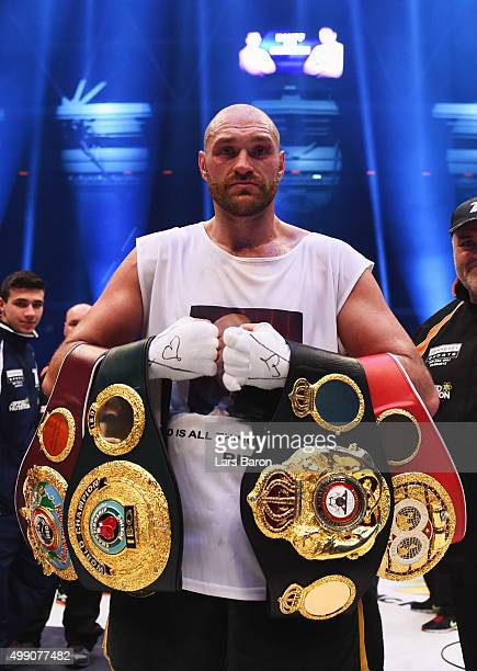 Tyson Fury celebrates with belts as he defeats Wladimir Klitschko to become new World Heavyweight Champion after the IBF IBO WBA WBO Heavyweight...