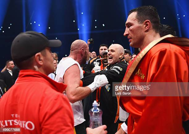 Tyson Fury celebrates with trainer Peter Fury as he defeats Wladimir Klitschko to become new World Heavyweight Champion during the IBF IBO WBA WBO...