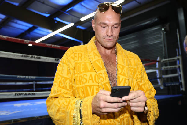 Tyson Fury checks his phone before his workout at the Top Rank Gym on May 4, 2021 in Las Vegas, Nevada.