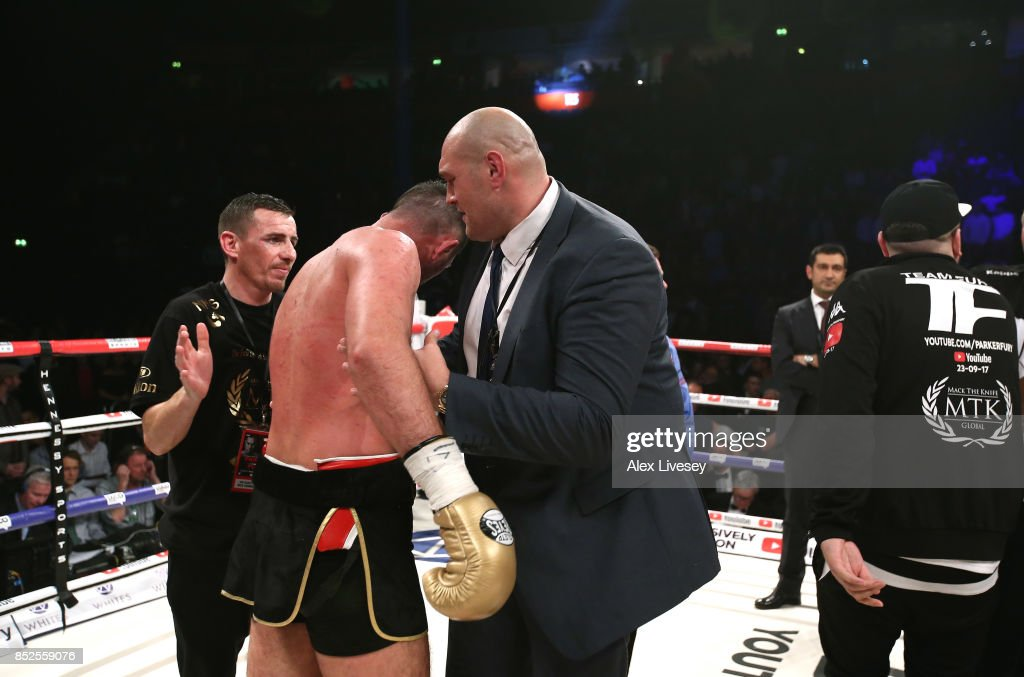 Tyson Fury embraces Hughie Fury after the WBO World Heavyweight Title fight at Manchester Arena on September 23, 2017 in Manchester, England.