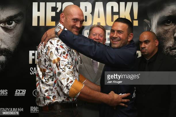 Tyson Fury embraces Sefer Seferi during the Tyson Fury and Sefer Seferi Press Conference on June 6 2018 in Manchester England