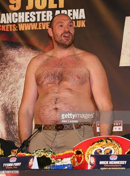 Tyson Fury faces the media bare chested during a press conference ahead of his fight with Wladimir Klitschko at the Manchester Arena on April 27,...