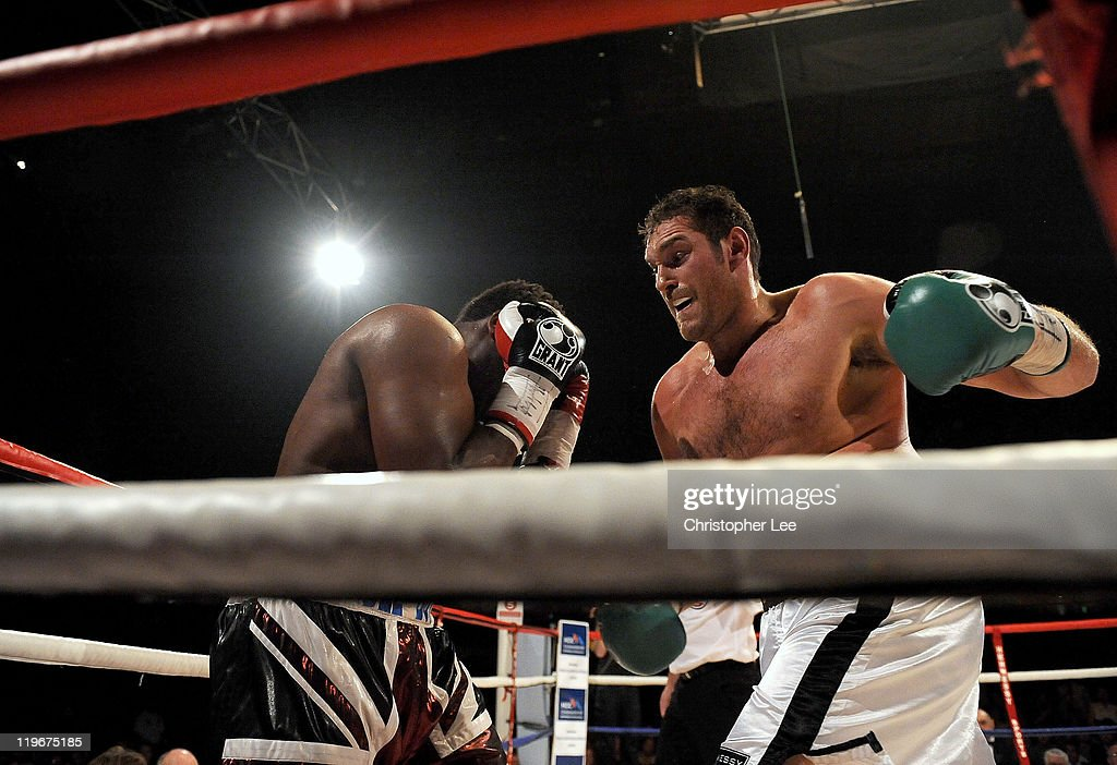Tyson Fury (R) gets Dereck Chisora in the corner during the British & Commonwealth Heavyweight Title Fight between Dereck Chisora and Tyson Fury at Wembley Arena on July 23, 2011 in London, England.