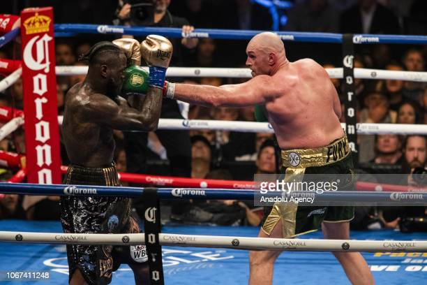Tyson Fury gets through the defense and lands a left hand against Deontay Wilder during WBC Heavyweight Championship at the Staples Center in Los...