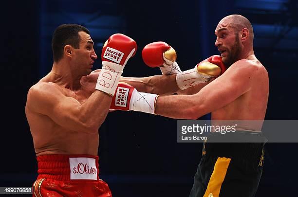 Tyson Fury in action with Wladimir Klitschko during the IBF IBO WBA WBO Heavyweight World Championship contest at EspritArena on November 28 2015 in...