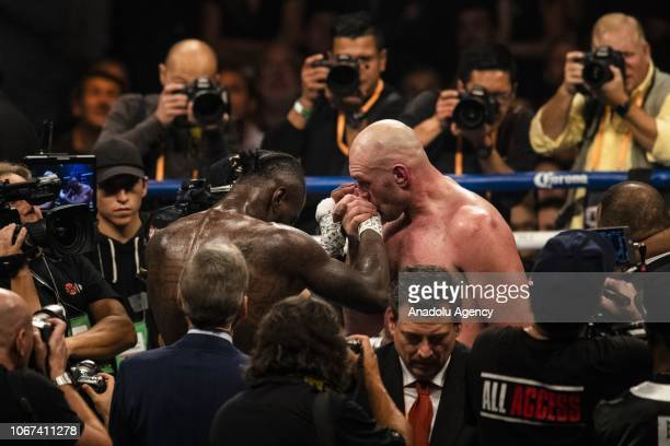 Tyson Fury kisses Deontay Wilder on his hand at the end of WBC Heavyweight Championship at the Staples Center in Los Angeles California on December...