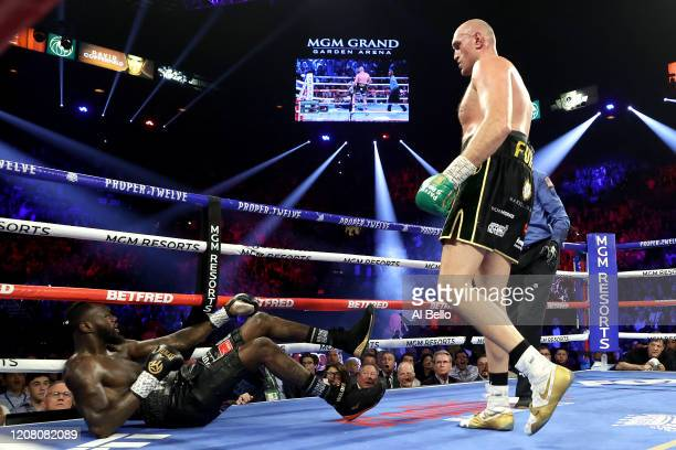 Tyson Fury knocks down Deontay Wilder during their Heavyweight bout for Wilder's WBC and Fury's lineal heavyweight title on February 22 2020 at MGM...