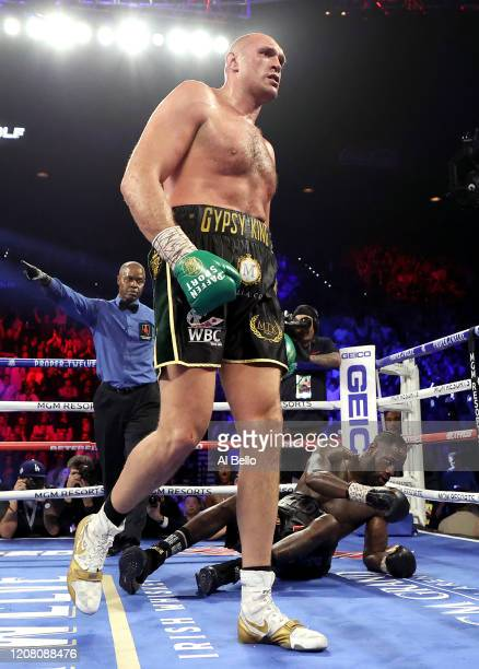 Tyson Fury knocks down Deontay Wilder in the fifth round during their Heavyweight bout for Wilder's WBC and Fury's lineal heavyweight title on...