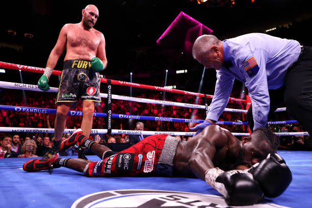 Tyson Fury knocks out Deontay Wilder in the 11th round during their WBC heavyweight title fight at T-Mobile Arena on October 09, 2021 in Las Vegas,...