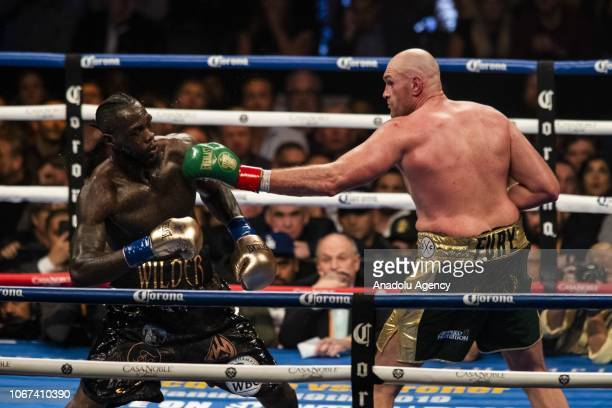 Tyson Fury lands a left hand against Deontay Wilder during WBC Heavyweight Championship at the Staples Center in Los Angeles California on December...