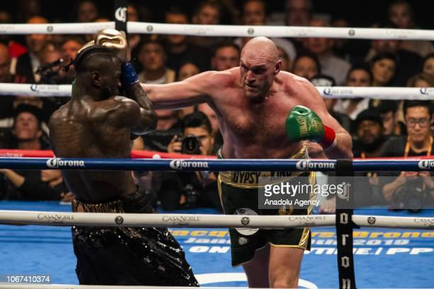 Tyson Fury lands a right hand against Deontay Wilder during WBC Heavyweight Championship at the Staples Center in Los Angeles California on December...