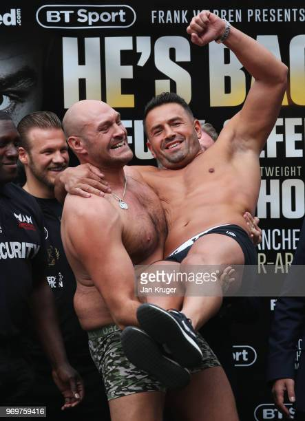 Tyson Fury lifts opponent Sefer Seferi during the weigh-in ahead of their heavyweight fight at Great Northern Amphitheatre on June 8, 2018 in...
