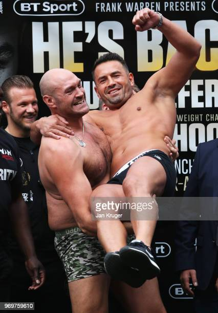 Tyson Fury lifts opponent Sefer Seferi during the weighin ahead of their heavyweight fight at Great Northern Amphitheatre on June 8 2018 in...