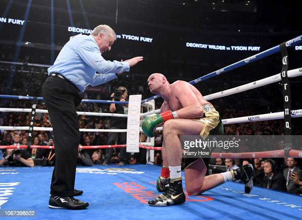 Tyson Fury looks up as he receives a count from referee Jack Reiss in the ninth round fighting to a draw with Deontay Wilder during the WBC...