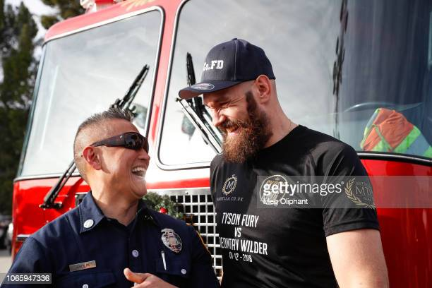 Tyson Fury meets with firefighters at the Los Angeles County Fire Department Headquarters on November 27 2018 in Los Angeles California