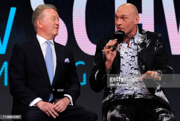 Tyson Fury of England speaks to promoter Frank Warren during a press conference ahead of his heavyweight match against Tom Schwarz at BT Sport...