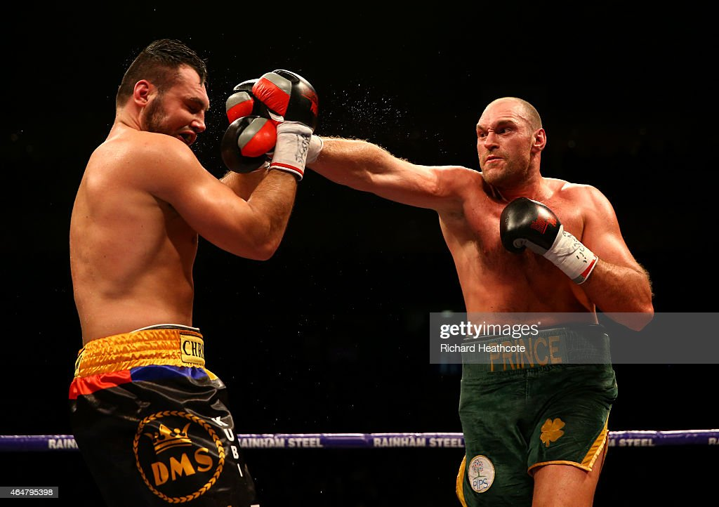Tyson Fury (green shorts) on his way to victory over Christian Hammer in a Heavyweight Contest by singing 'Elvis' at the O2 Arena on February 28, 2015 in London, England.
