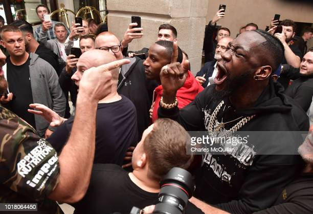 Tyson Fury points his finger at rival boxer Deontay Wilder as they goad one another following Fury's weigh in for his fight with Francesco Pianeta on...