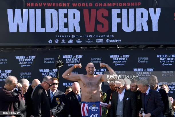 Tyson Fury poses during the Deontay Wilder v Tyson Fury weighin at Los Angeles Convention Center on November 30 2018 in Los Angeles California