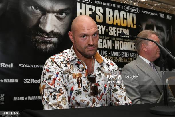 Tyson Fury poses for a photograph during the Tyson Fury and Sefer Seferi Press Conference on June 6 2018 in Manchester England