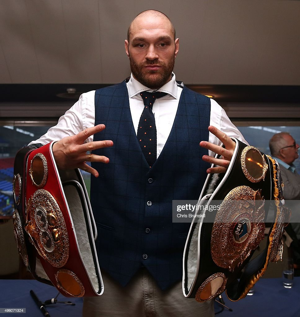 Tyson Fury poses with his belts following a press conference at the Macron Stadium on November 30, 2015 in Bolton, England.