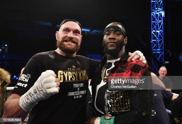 Tyson Fury poses with rival boxer Deontay Wilder after defeating Francesco Pianeta in a heavyweight contest at Windsor Park on August 18 2018 in...
