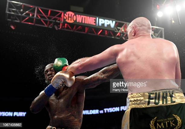 Tyson Fury punches Deontay Wilde in the fifth round fighting to a draw during the WBC Heavyweight Championship at Staples Center on December 1 2018...