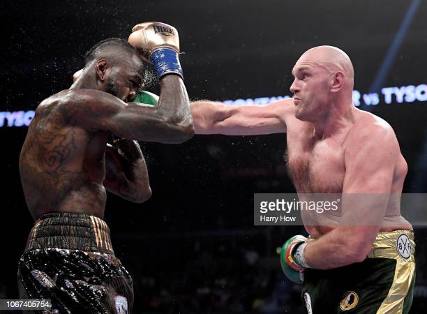 Tyson Fury punches Deontay Wilde in the seventh round fighting to a draw during the WBC Heavyweight Championship at Staples Center on December 1 2018...