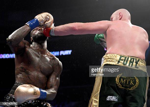 Tyson Fury punches Deontay Wilde in the sixth round fighting to a draw during the WBC Heavyweight Championship at Staples Center on December 1 2018...