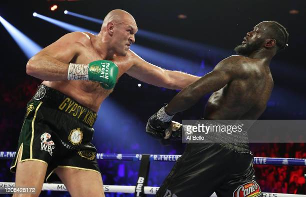 Tyson Fury punches Deontay Wilder during their Heavyweight bout for Wilder's WBC and Fury's lineal heavyweight title on February 22 2020 at MGM Grand...