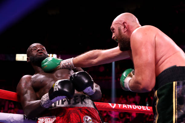 Tyson Fury punches Deontay Wilder during their WBC heavyweight title fight at T-Mobile Arena on October 09, 2021 in Las Vegas, Nevada.