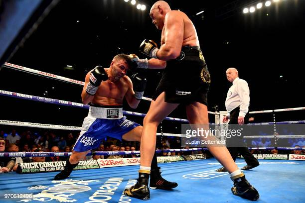 Tyson Fury punches Sefer Seferi during there heavyweight contest at Manchester Arena on June 9 2018 in Manchester England