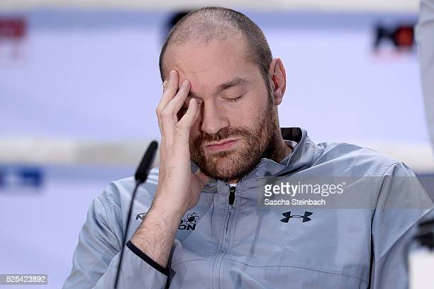 Tyson Fury reacts as Wladimir Klitschko speaks to the media during Tyson Fury and Wladimir Klitschko head to head press conference on April 28 2016...