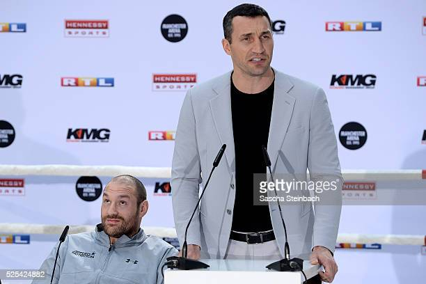 Tyson Fury reacts as Wladimir Klitschko speaks to the media during their head to head press conference on April 28 2016 in Cologne Germany Fury v...