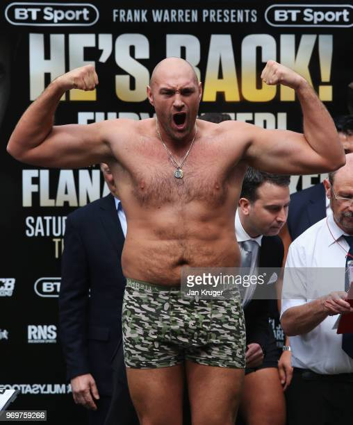 Tyson Fury reacts during the weighin ahead of the heavyweight fight against Sefer Seferi at Great Northern Amphitheatre on June 8 2018 in Manchester...
