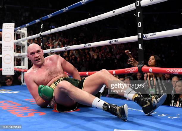 Tyson Fury reacts to his knock down in the ninth round fighting to a draw with Deontay Wilder during the WBC Heavyweight Championship at Staples...